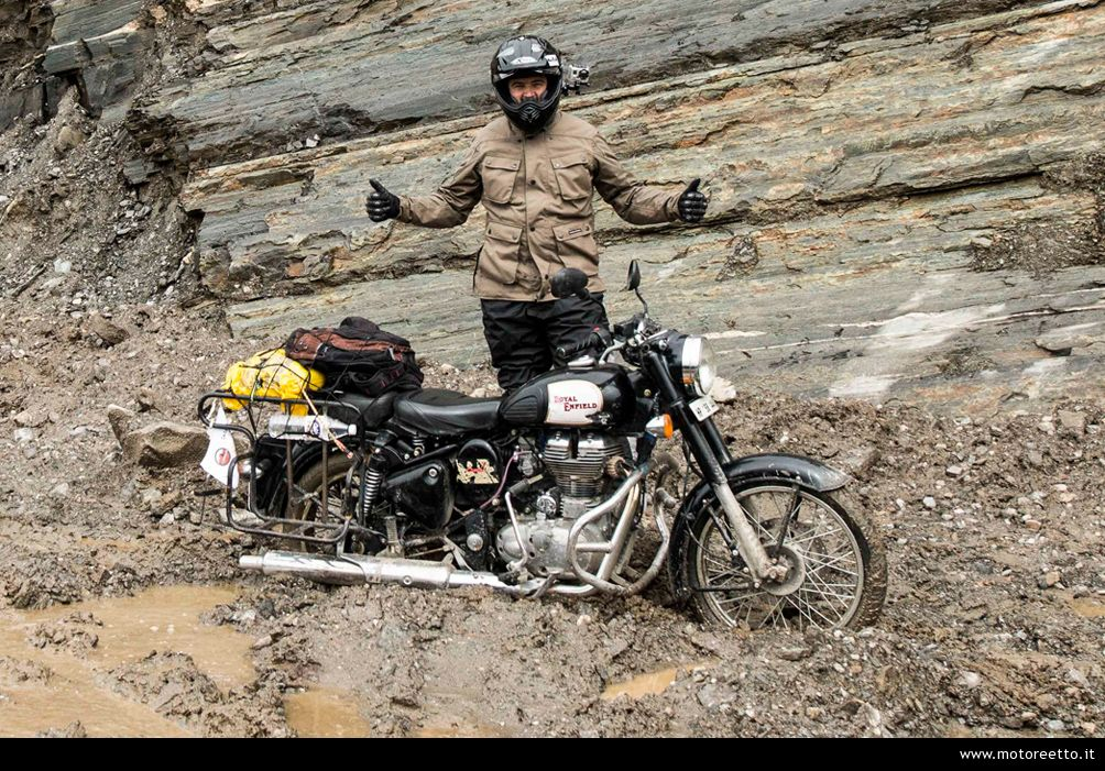 motoreetto in the mud of rohtang pass ladakh himalaya